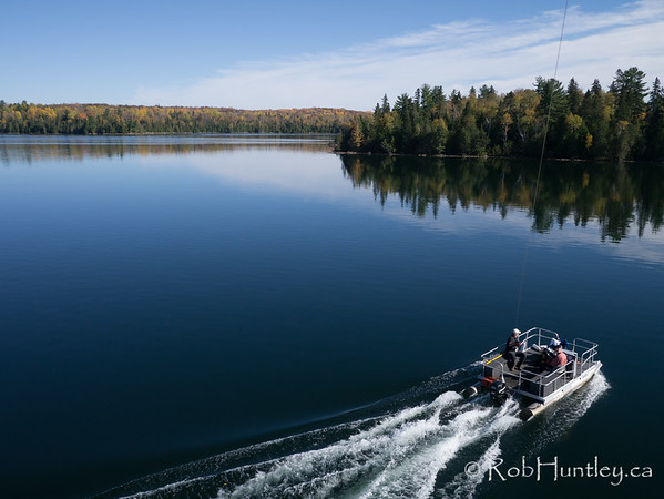 Pontoon boat on Big Cedar Lake.  Aerial photography.