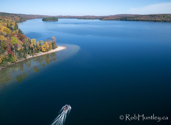 Pontoon boat on Big Cedar Lake, Quebec.  Aerial photography.