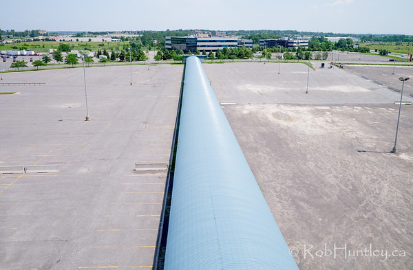 Covered walkway in parking lot at Canadian Tire Centre.  Aerial photography.