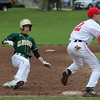 Marblehead, Ma. 5-22-17. Kevin Durant, of Lynn Classical High School, slides safely into third base before Chirs Gally gets the ball.
