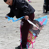 Revere, Ma. 5-21-17. Soeun Chea, untangles his kite string from that of his daughter on Revere Beach during the Revere Beach Kite Festival on Sunday.