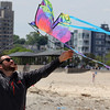 Revere, Ma. 5-21-17. Mario Marenghi sets a kite for his daughter Giuliana on Revere Beach during the Revere Beach Kite Festival on Sunday.