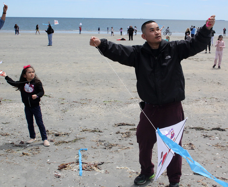 Revere, Ma. 5-21-17. Jolie Chea and Soeun Chea flying kites on Revere Beach during the Revere Beach Kite Festival on Sunday.