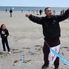 Revere, Ma. 5-21-17. Jolie Chea and Soeun Chea flying kites on Revere Beach during the Revere Beach Kite Festival on Sunday.