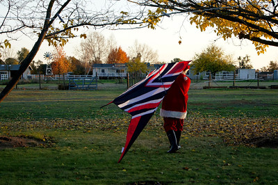 Santa heading out to our backyard (field)... to fly John's 14' black, white and red delta made by Premier Kites.