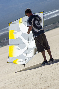 Published in Summer 2013, vol 35, issue 2: AKA Kiting, The Journal of the American Kitefliers Association. (p. 45)   [On the Playa: Kevin Bayless getting ready to fly his Ribbon Rokk ~ an original design hand made by Kevin]