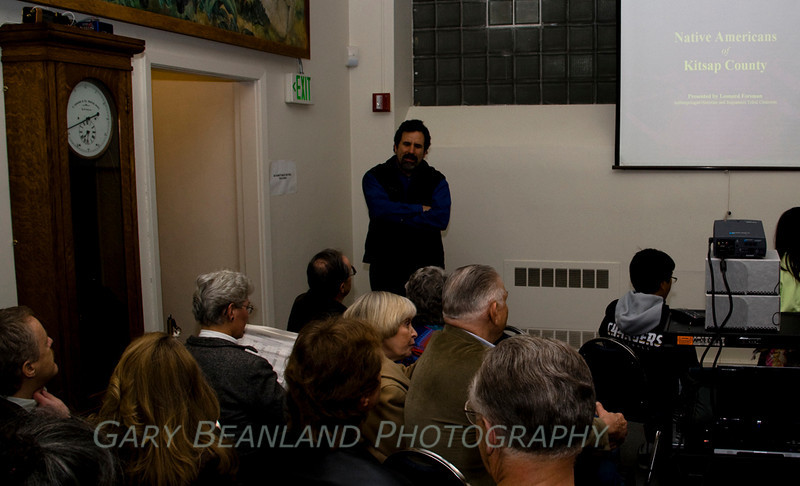 Suquamish Tribal Chairman Leonard Forsman chats with the audience before he begins his presentation Native Americans of Kitsap County at the First Friday event at the Kitsap Historical Museum.