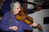 Vivian Williams fiddles a pioneer tune.