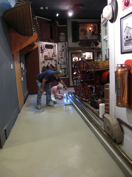 Gary and the roller at work!  Sara Nell painting trim.