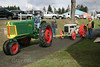 Member of Olympic Peninsula Antique Tractor & Engine Association check the hitch as the Fordson Tractor begins to be towed across the street to the secure holding area.