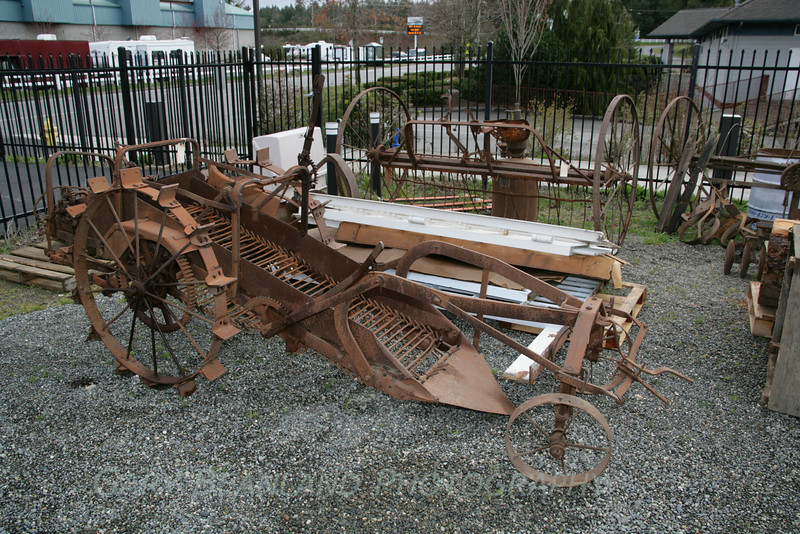 The potato digger and other large pieces such as the jail doors and hay rake are stored in the fenced area.
