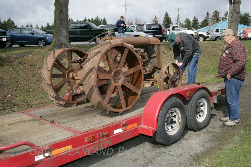 The old tractor is loaded on Pete Britton's trailer to be moved across the street for storage.