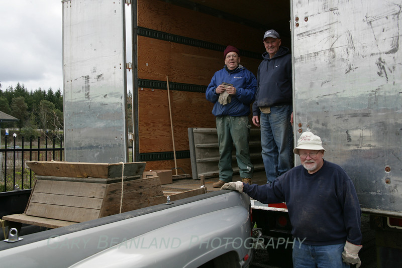 Bob Ulsh stops by to help Mark Williamson and George Willock unload the trailers.