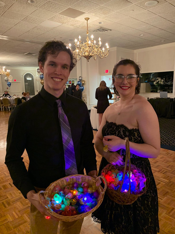 . Volunteers Scott Wheeler and Abigail Gilmore of Lowell