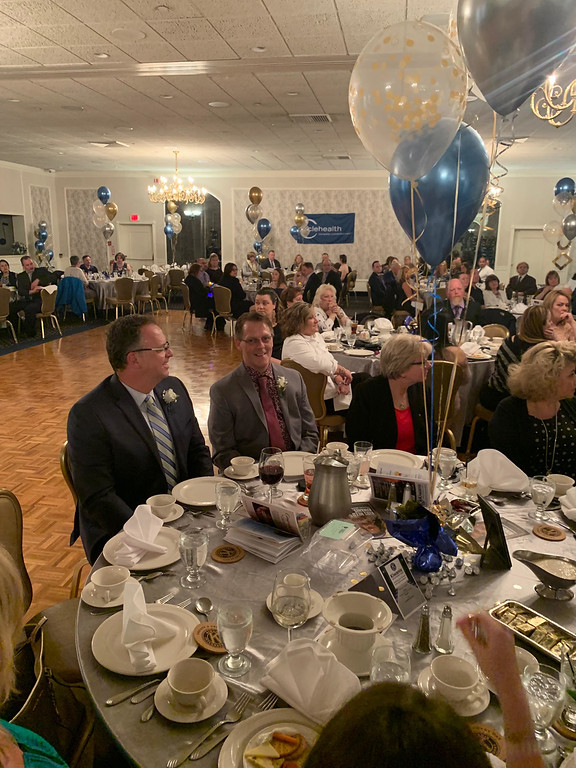 . Honoree Robert Skirvin-Orr and husband Andrew Orr-Skirvin enjoy dinner with guests.