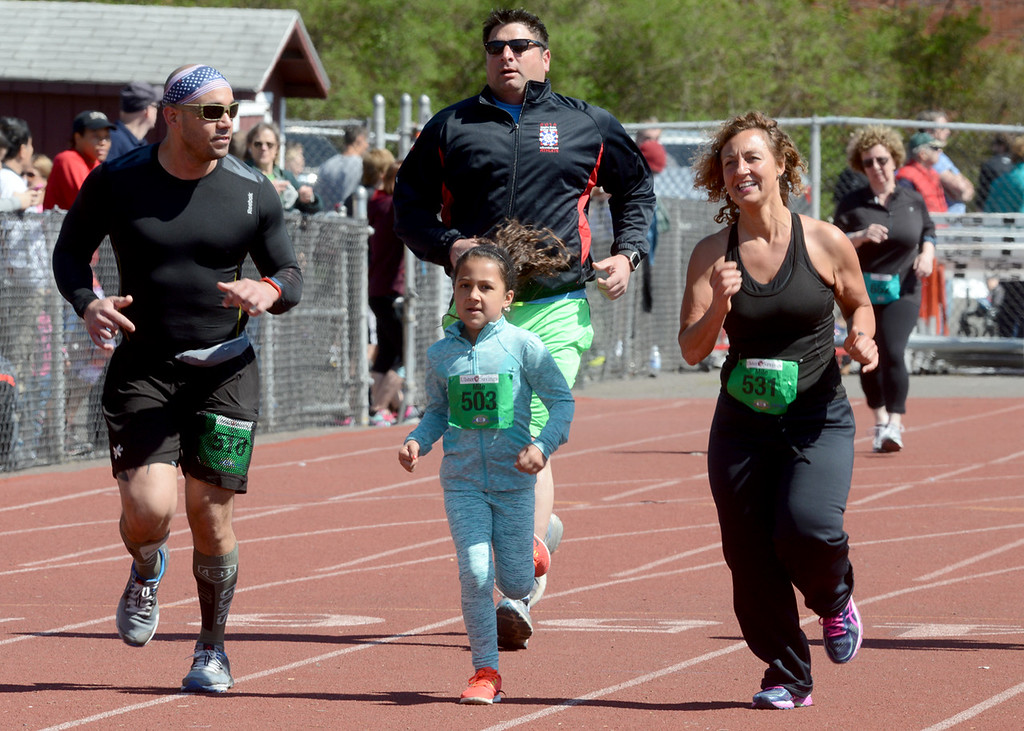. Tania Barricklo-Dailly Freeman  Alexander Saldivar of Rome, NY, left, Isabella Perez of Accord, center , and Tabitha Ziba, also of Accord ,make the final stretch of the Friends and Family Mile race at the Kiwanis Kingston Classic at Dietz Stadium.The event was held Sunday.