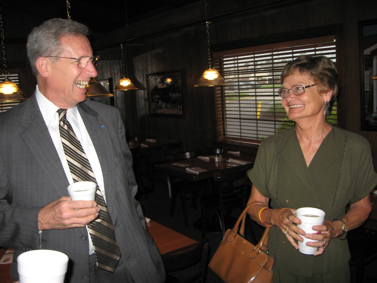 United Way CEO, Charlie Colvin - guest speaker for the day, talking to guest Linda Wilson, beautiful wife of member George Wilson