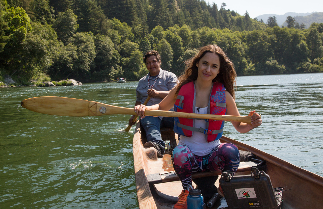 Chilean Actress Juanita Ringleing Vicuña and Sammy Gensaw, a Klamath native, paddle a traditional redwood dugout canoe to the final celebration with the Rios to Rivers program in Requa. (Weston Boyles - Contributed photo)