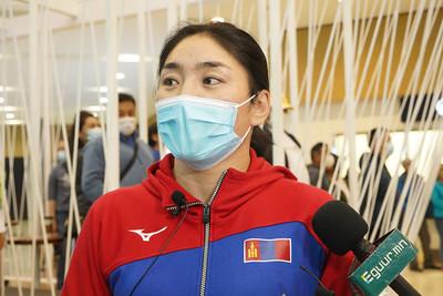 """2021 оны наймдугаар сарын 12. """"Токио-2020"""" зуны 32 дугаар олимпод оролцсон чөлөөт бөх, хөнгөн атлетикийн тамирчид болон дасгалжуулагчид эх орондоо ирлээ. ГЭРЭЛ ЗУРГИЙГ И.НОМИН/MPA"""
