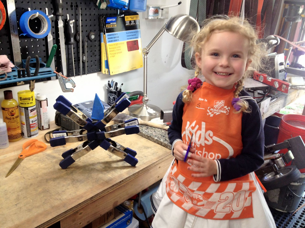 Since all of the grinding was done, I brought in my shop assistant to help me epoxy & clamp the pikal scales.  You can see it all clamped-up to her right.
