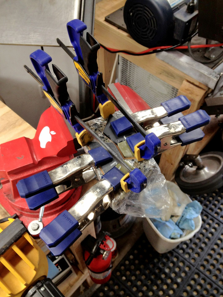 The scale materials have been cut, shaped, fitted, cleaned, epoxied, and clamped.