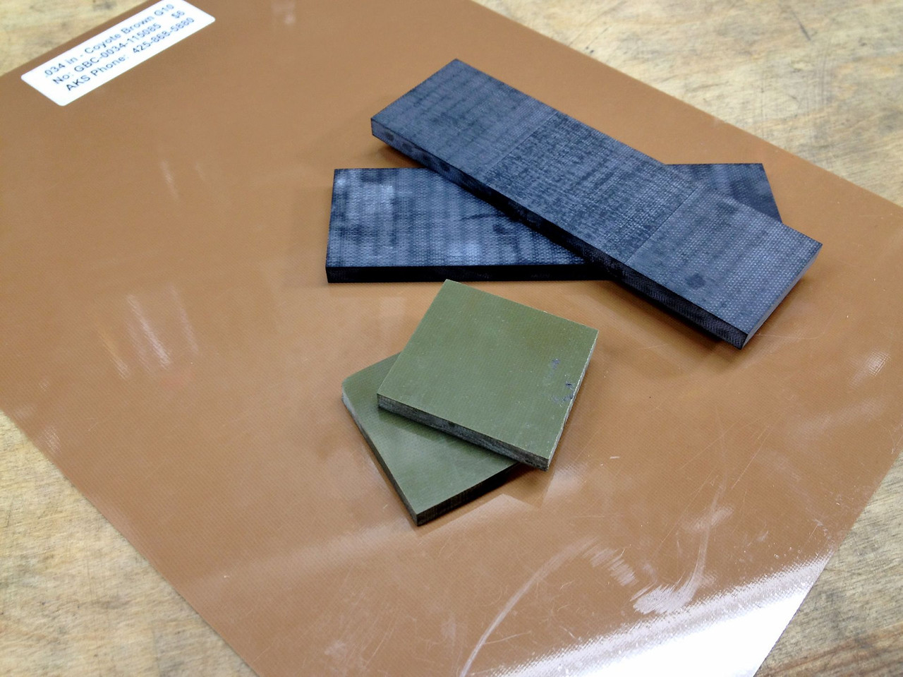 """Here is the scale material I will be using.  .25"""" black G10, .25"""" OD green G10 for bolsters (this was left over from another knife), and .034"""" coyote brown G10 for liners."""