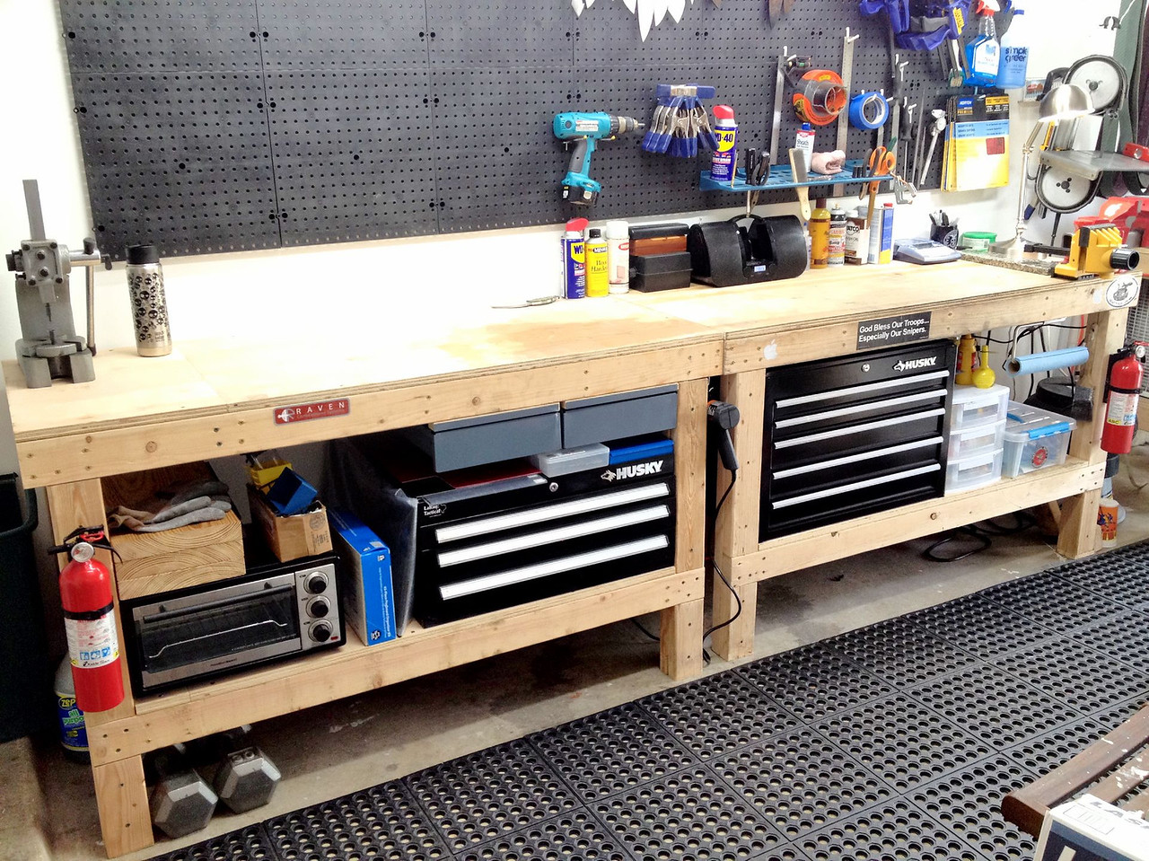 I haven't posted a progress update in a few days, so I thought I'd share what I've been up to.<br /> <br /> I found myself increasingly irritated with the state of my shop, so I ceased working on knives and started working on improving shortfalls of the shop.<br /> <br /> The first order of business was to increase storage.  Specifically knife storage.  I haven't had a suitable place for finished knives, so they've just been sitting on the workbench with a blue shop towel over them.  Any heavy grinding resulted in steel or wood or G10 dust all over my pretty knives that were awaiting sheaths.<br /> <br /> Here you can see how the shop looks as of today.  I've added a 5-drawer tool chest and mounted 2 metal drawers in the sheath/finishing bench and 1 metal drawer in the grinding/drilling bench.  I've also rearranged many things to improve effeciency and workflow.