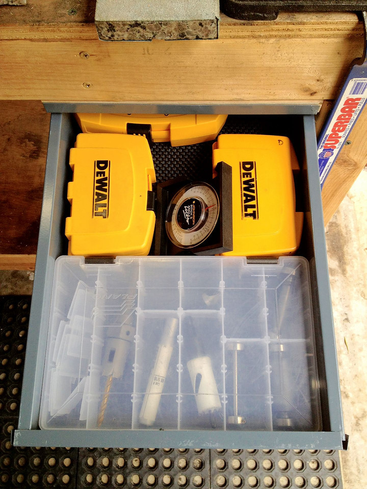 Here's the new metal drawer I installed in the grinding/drilling bench.  It holds my drill bits, my handy-dandy angle finder, and a case that holds my counter bores, counter sinks, hole saws, and small wheels.