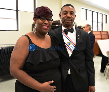 Knight of Columbus Walter Olieh and his wife Tameka stand for a picture at an exemplification ceremony September 7 at St. Anthony Catholic Church in Wylie. (Jenna Teter/Special Contributor)