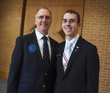 Patrick Fletcher, left, stands with his son, Holy Trinity Seminary's Kyle Fletcher who became a 4th degree knight earlier in the day at an exemplification banquet September 7 at St. Anthony Catholic Church in Wylie. (Jenna Teter/Special Contributor)