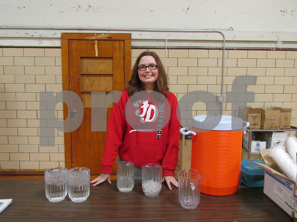 Delaney McEvoy is serving drinks at the Knight of Columbus Fish Fry