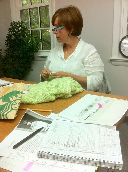 Aida knitting lime green.  Not a grandma yet. <br /> September 28.