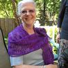 Maria at Carolyn's house in a shawl knit by Carolyn.