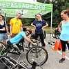 Checking out this new type of off-road trike wheelchair is Greg Durso 33 of Stony Brook, NY, and looking on is L-R, Chelsea White, Jonathan Martel, Nicole Bartlebaugh and Anna Hausermann (both with MGH/IHP program), all at the 4th annual Knobby Tire Ride and Roll event for the Empower Spinal Cord Injury held at Great Brook Farm State Park in Carlisle. SUN/David H. Brow