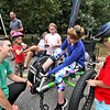 NorthEast Passage company rep Crystal Skahan of Durham NH, on left, helps Kara Spurr of Wilmington get set-up in a Fat Trike wheelchair, as Crystal's children look on L-R, Eisley Skahan 6, Molly Skahan 9, and Grady Skahan 7. SUN/David H. Brow