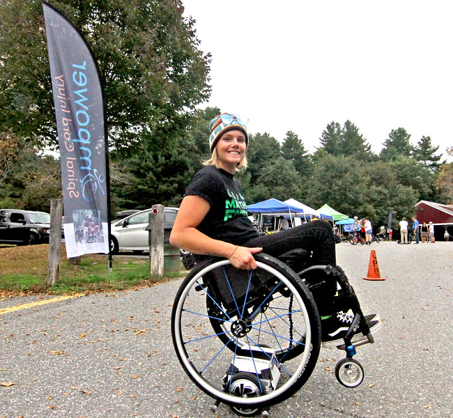 Trying out a Wheelchair Hoverboard is Empower volunteer Brenna Bean 26 of Whately, Ma., at the 4th annual Knobby Tire Ride and Roll event at Great Brook Farm State Park in Carlisle. SUN/David H. Brow