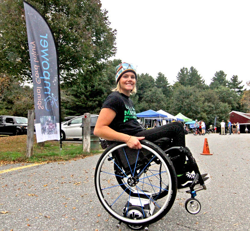 . Trying out a Wheelchair Hoverboard is Empower volunteer Brenna Bean 26 of Whately, Ma., at the 4th annual Knobby Tire Ride and Roll event at Great Brook Farm State Park in Carlisle. SUN/David H. Brow