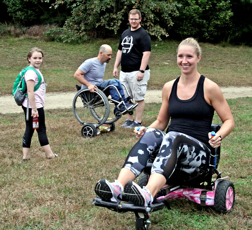 . Trying out a Cart-Bot at the Knobby Tire Ride and Roll event is Tori Lehr a student at the American International Collage, she is studing occupational therapy. SUN/David H. Brow