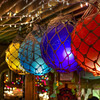 Glass fishing floats at La Mariana. I love how you can see the reflection of the Christmas lights across the room in the floats. © Sugar + Shake