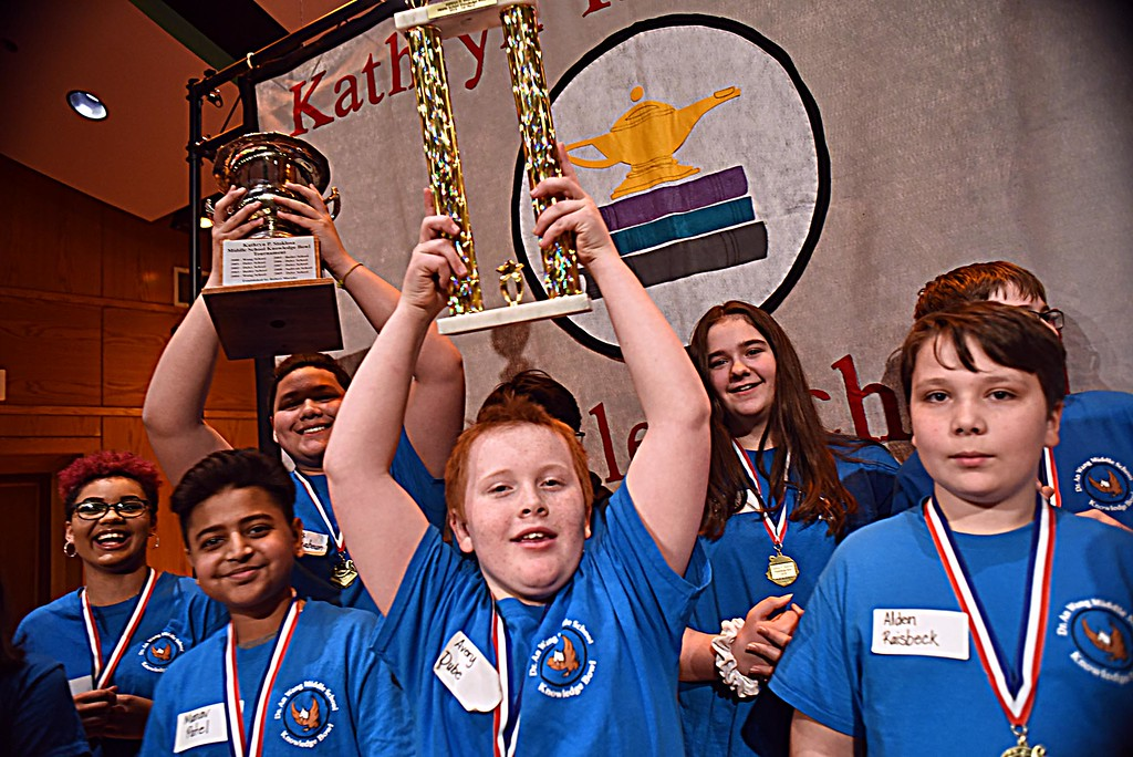 . 1st place winners in the Knowledge Bowl are Middle School students from the Wang School celebrate their win in front is L-R, Manav Patel, Avery Dube and Alden Raisbeck. SUN/ David H. Brow