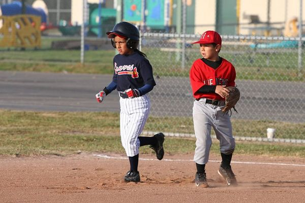 #03 Evelyn Loyola running to second past first baseman #17 Anthony Aranda, Braves vs. Nationals, 2005 Ocean View Pony Baseball, Pinto Division