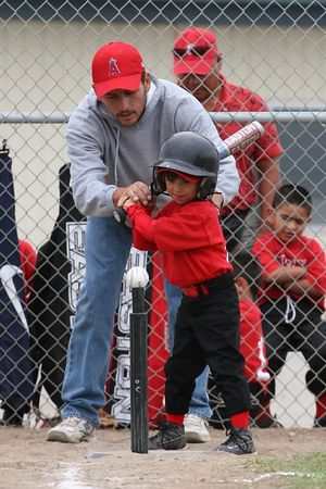Coach Satu Rodarte helping #04 Breanna Loyola get ready to bat, Royals vs. Angels, 2005 Ocean View Pony Baseball, Shetland Division