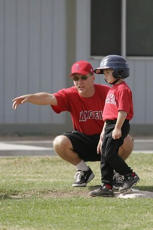 Coach Pat Kane talking to #05 Christopher Kane about base running, Royals vs. Angels, 2005 Ocean View Pony Baseball, Shetland Division