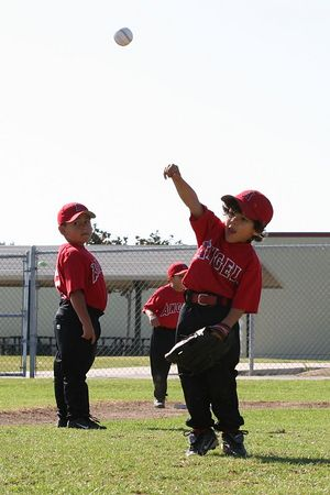 #02 Brandon Quirarte throwing the ball with #12 Daniel Bustillos looking on, Tigers vs. Angels, 2005 Ocean View Pony Baseball, Shetland Division