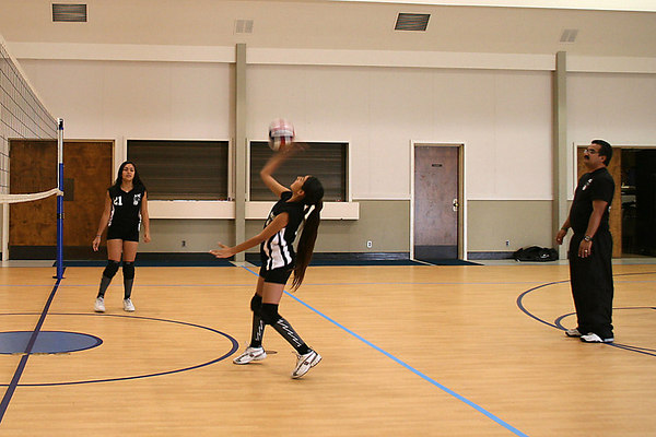 #1 Marilynn Mendoza and #21 Anissa Keown with Coach David Chavez looking on. 2006 ACEZ 14-1 Volleyball