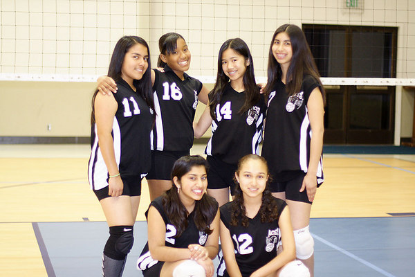 #11 Alexis Nunez, #16 Chondra Ward, #14 JessiAnne Dejarme and #7 Brittany Camacho. #2 Tasha Gorrell and #12 Tracy Hernandez. 2006 ACEZ Volleyball.