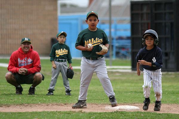 #13 Edvardo Gallegos making an out at 2nd base. Athletics vs. Yankees, 2006 North Side Little League Baseball, Tee Ball Division
