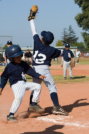 #03 J.J. Zaragoza beat by the throw to 1st base. Pinto North Side Yankees vs. Tigers, 2006 Ocean View Pony Baseball, Pinto Division.