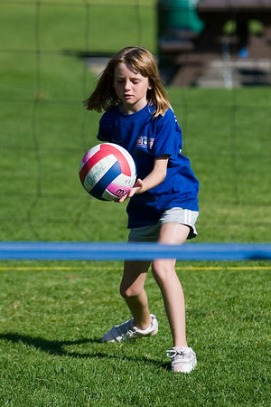 Sydney Kane serving the ball. Blue Dolphins, US Youth Volleyball League.
