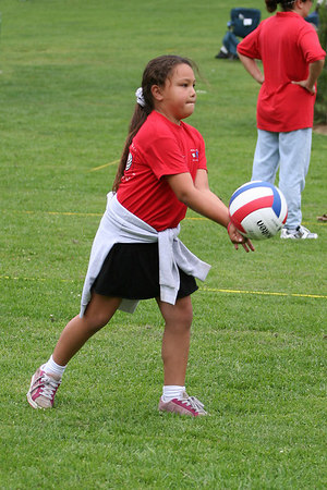 Alanna Quilantang serving the ball. Red Robins, US Youth Volleyball League.